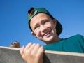 Portrait boy holding a skateboard.