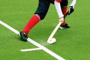 field hockey on a grass