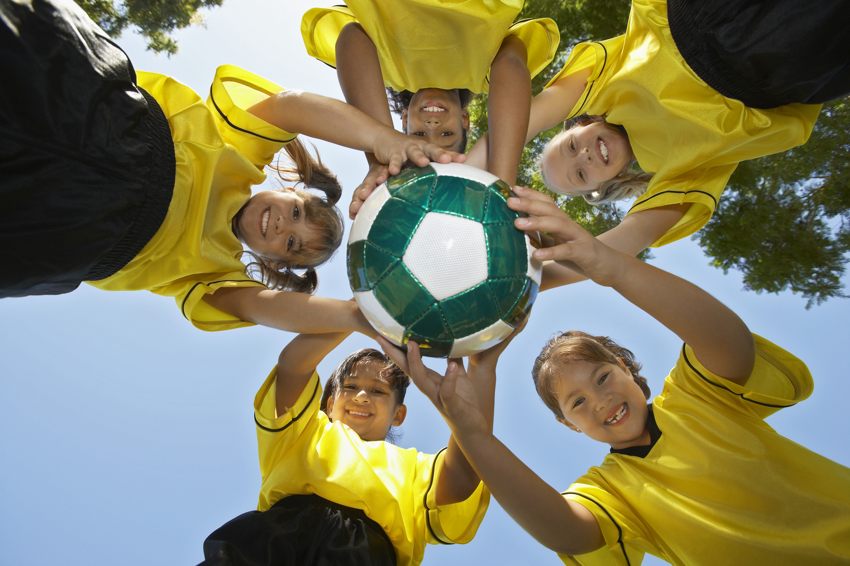Teenage Football Team Holding Football
