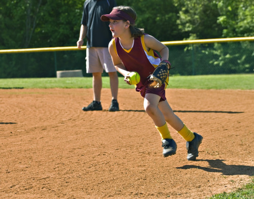 Young Softball Player fielding the ball